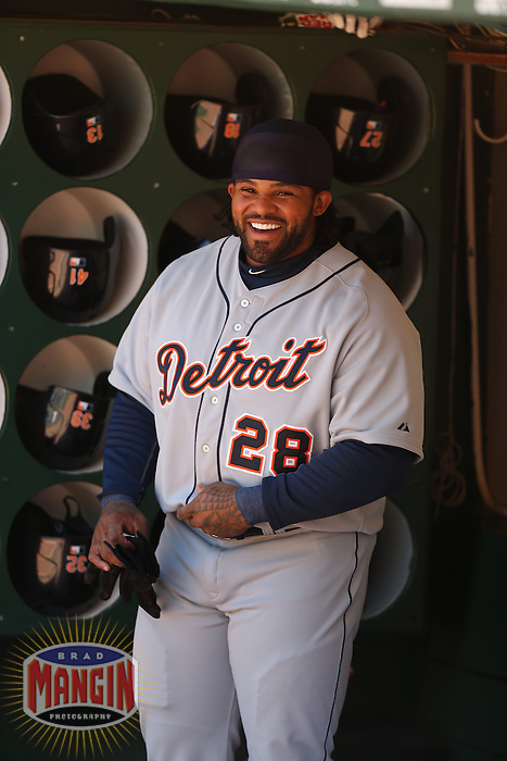 OAKLAND, CA - APRIL 14:  Prince Fielder #28 of the Detroit Tigers gets ready in the dugout before the game against the Oakland Athletics on Sunday, April 14, 2013 at The O.co Coliseum in Oakland, California. Photo by Brad Mangin