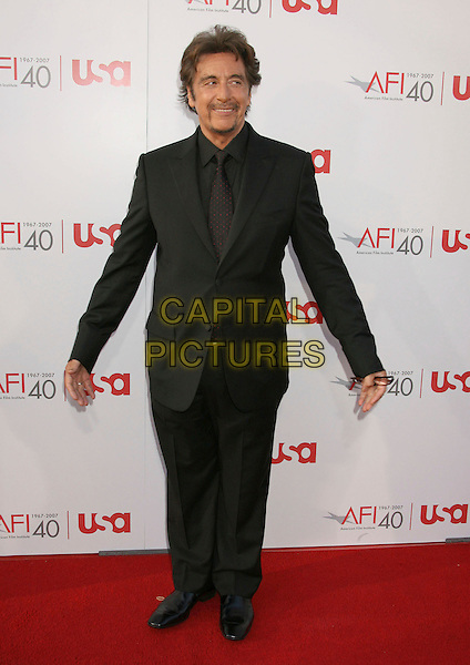 AL PACINO .35th AFI Life Achievement Award Honoring Al Pacino held at the Kodak Theatre, Hollywood, California, USA..June 7th, 2007.full length black suit goatee facial hair arms.CAP/ADM/RE.©Russ Elliot/AdMedia/Capital Pictures