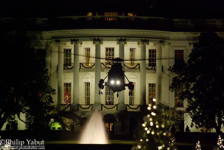 Marine One executes a night takeoff from the South Lawn of the White House.