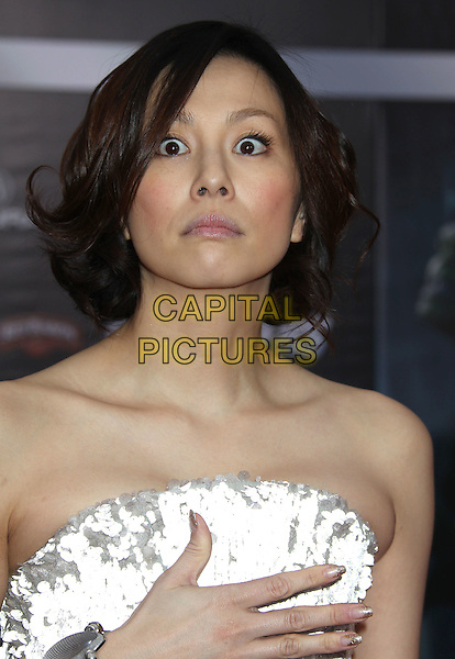 "Ryoko Yonekura.""Marvel's The Avengers"" World Premiere held at the El Capitan Theatre, Hollywood, California, USA..April 11th, 2012.headshot portrait white strapless hand wide eyes funny looks shocked surprised .CAP/ADM/RE.©Russ Elliot/AdMedia/Capital Pictures."