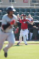 Kannapolis Intimidators starting pitcher Spencer Adams (12) makes a throw to first base against the Hickory Crawdads at CMC-Northeast Stadium on May 21, 2015 in Kannapolis, North Carolina.  The Intimidators defeated the Crawdads 2-0 in game one of a double-header.  (Brian Westerholt/Four Seam Images)