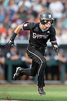 Mississippi State Bulldogs outfielder Jake Mangum (15) runs to first base during Game 4 of the NCAA College World Series against the Auburn Tigers on June 16, 2019 at TD Ameritrade Park in Omaha, Nebraska. Mississippi State defeated Auburn 5-4. (Andrew Woolley/Four Seam Images)