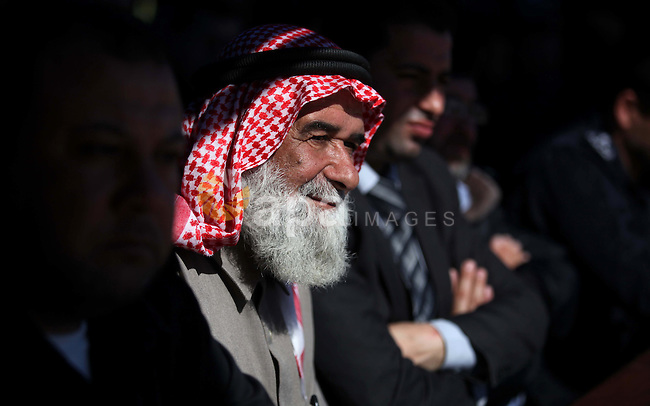 Palestinians attend a graduation ceremony of policemen loyal to Hamas in Gaza City January 29, 2014. Photo by Ashraf Amra