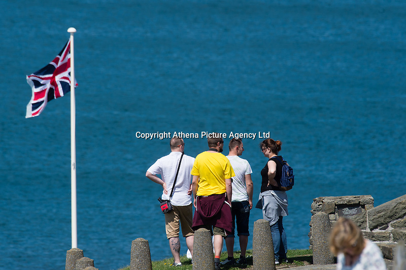 Aberystwyth Wales Uk, Sunday 08 May 2016<br /> Pictured: A group of people enjoy the view<br /> UK Weather : As temperatures reach the upper 20's centigrade in parts of Britain, people enjoy the warm May sunshine in Aberystwyth on the Cardigan Bay coast in West Wales.