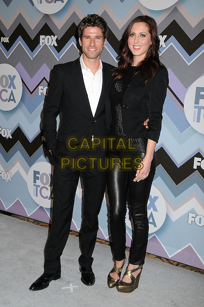 Kyle Martino, Eva Amurri.FOX All-Star Party TCA Winter 2013 Press Tour held at the Langham Huntington Hotel and Spa, Pasadena, California, USA..January 8th, 2013.full length black suit leather trousers married husband wife gold shoes blazer  .CAP/ADM/BP.©Byron Purvis/AdMedia/Capital Pictures.