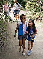 Daisy members and friends, Riley Ferguson, 7, left, and Riley De Sagun, 6, right, walk together along a path at the Fullerton Arboretum during the Bug Safari guided tour.