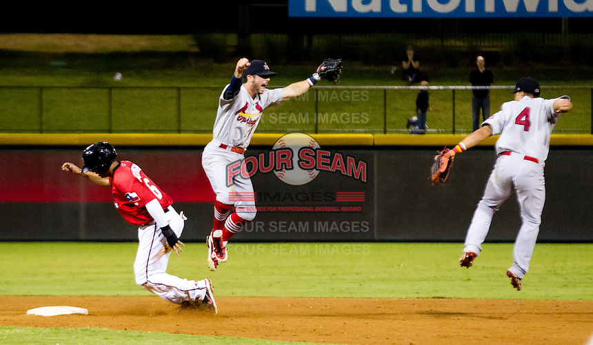 Greg Garcia (7) and Kolten Wong (4) of the Springfield Cardinals leap in the air after game 3 of the Texas League Championship Series against the Frisco RoughRiders at Dr. Pepper BallPark on September 15, 2012 in Frisco, TX.  The Cardinals became the 2012 Texas League Champions after defeating the RoughRiders 2-1. (David Welker/Four Seam Images)