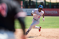 Stockton Ports left fielder Dairon Blanco (5) hustles to third base during a California League game against the Visalia Rawhide at Visalia Recreation Ballpark on May 9, 2018 in Visalia, California. Stockton defeated Visalia 4-2. (Zachary Lucy/Four Seam Images)