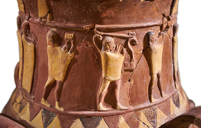 Close up of the Inandik Hittite relief decorated cult libation vase decorated with relif figures coloured in cream, red and black. The processional figures include musicians and acrobats, mid to late 16th century BC - İnandıktepe, Turkey. Against a white background