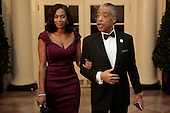 Reverend Al Sharpton, right, and Aisha I. McShaw arrive to a state dinner hosted by U.S. President Barack Obama and U.S. First Lady Michelle Obama in honor of French President Francois Hollande at the White House in Washington, D.C., U.S., on Tuesday, Feb. 11, 2014. Obama and Hollande said the U.S. and France are embarking on a new, elevated level of cooperation as they confront global security threats in Syria and Iran, deal with climate change and expand economic cooperation. <br /> Credit: Andrew Harrer / Pool via CNP