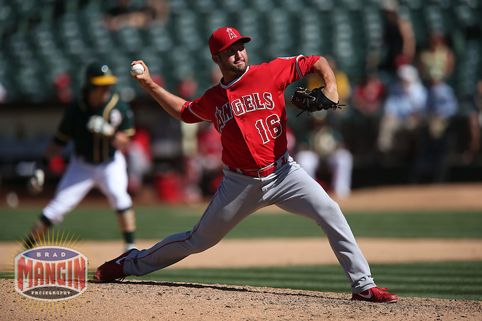 OAKLAND, CA - APRIL 30:  Huston Street #16 of the Los Angeles Angels pitches against the Oakland Athletics during the game at O.co Coliseum on Thursday, April 30, 2015 in Oakland, California. Photo by Brad Mangin