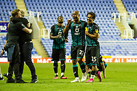 Andre Ayew of Swansea City and Wayne Routledge of Swansea City celebrate at full time during the Sky Bet Championship match between Reading and Swansea City at the Madejski Stadium in Reading, England, UK. Wednesday 22 July 2020.