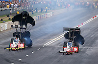 Jul. 19, 2014; Morrison, CO, USA; NHRA top fuel driver J.R. Todd (right) slows down alongside Doug Kalitta during qualifying for the Mile High Nationals at Bandimere Speedway. Mandatory Credit: Mark J. Rebilas-