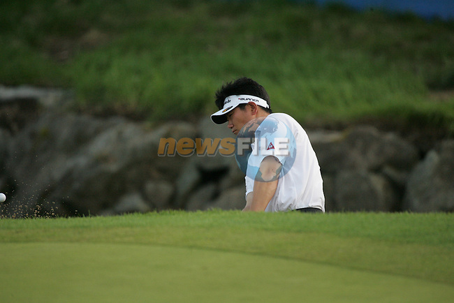 Y E Yang chips out of the bunker on the newly shortened par 3 18th green during the first round of the Smurfit Kappa European Open at The K Club, Strffan,Co.Kildare, Ireland 5th July 2007 (Photo by Eoin Clarke/NEWSFILE)