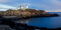York County, ME<br /> Cape Neddick - Nubble - Light Station (1879) at low tide under approaching storm clouds