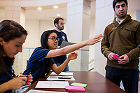 Meredith Davis (left, seated at table), 26, and Claris Chang, 25, both Master in Public Policy grad students at Harvard, register attendees before a session of Resistance School at Harvard University's John F. Kennedy School of Government, on Thurs., April 27, 2017.