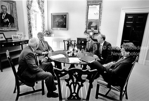 """Washington, DC - (FILE) -- United States President Bill Clinton meets with his close advisors at the White House in Washington, D.C. on Thursday, June 24, 1993.  From left to right: United States Secretary of Defense Les Aspin; President Clinton; White House Chief of Staff Thomas """"Mac"""" McLarty; Counselor to the President David Gergen; and Vice President Al Gore..Credit: White House via CNP"""