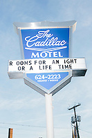 """A sign for The Cadillac Motel reading """"Rooms for a night or a lifetime"""" stands across from the the campaign headquarters of Kentucky senator and Republican presidential candidate Rand Paul in Manchester, New Hampshire."""