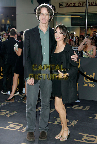 """JAY ROACH & SUSANNA HOFFS.""""Bruno"""" Los Angeles Premiere held at Grauman's Chinese Theatre, Hollywood, CA, USA..June 25th, 2009.full length jeans denim black jacket green shirt dress clutch bag married husband wife .CAP/ADM/MJ.©Michael Jade/AdMedia/Capital Pictures."""