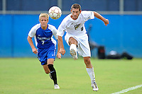 2 October 2011:  FIU's Nicholas Chase (8) advances the ball with Kentucky's Brendan Murphy (7) in pursuit in the first half as the FIU Golden Panthers defeated the University of Kentucky Wildcats, 1-0 in overtime, at University Park Stadium in Miami, Florida.