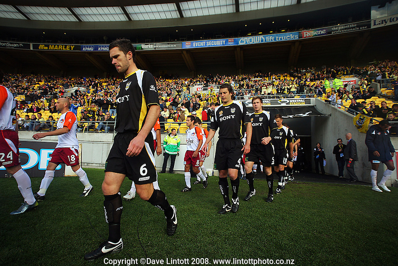 Tim Brown and the rest of the players walk onto the pitch before kick-off during the A-League football match between the Wellington Phoenix and Queensland Roar at Westpac Stadium, Wellington. Sunday, 26 October 2008. Photo: Dave Lintott / lintottphoto.co.nz