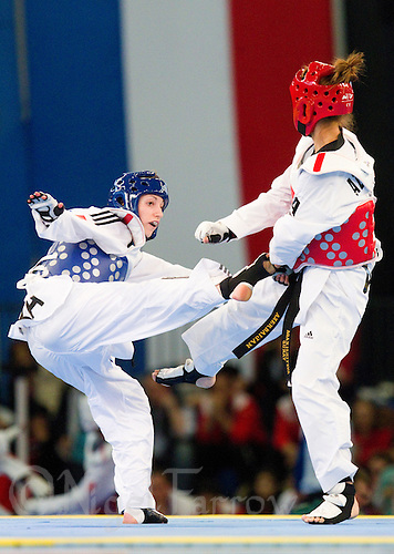 05 MAY 2012 - MANCHESTER, GBR - Floriane Liborio (FRA) of France (on left) aims a kick at Gunay Aghakishiyeva of Azerbaijan during their women's -57kg category second round contest at the 2012 European Taekwondo Championships at Sportcity in Manchester, Great Britain (PHOTO (C) 2012 NIGEL FARROW)