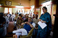 Dr. Vandana Shiva (extreme right) watches a video projection on farming with the Minister of Environment, Sr. Jairam Ramesh (seated in front), during the Regional Conference for Climate Change in Himalaya in the Navdanya conference room in Dehradun, Uttarakhand, India, on 6th September 2009...Dr. Vandana Shiva, the founder of Navdanya Foundation and Bijavidyapeeth, is a physicist turned environmentalist who campaigns against genetically modified food and teaches farmers to rely on indigenous farming methods.. .Photo by Suzanne Lee / For The National