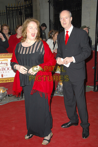 GUESTS .Attending the Galaxy British Book Awards held at the Grosvenor Hotel, Park Lane, London, England, .April 9th 2008.full length red tie black suit dress red shawl pashmina wrap .CAP/CAS.©Bob Cass/Capital Pictures
