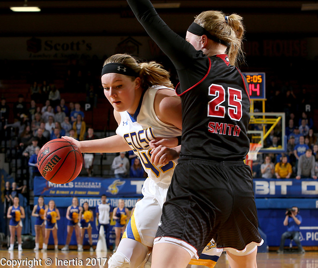 BROOKINGS, SD - MARCH 16:  Ellie Thompson #45 from South Dakota State University looks to make a move against Kelly Smith #25 from Northern Illinois during their first round WNIT game Thursday at Frost Arena in Brookings.(Photo by Dave Eggen/Inertia)