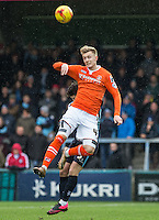 Joe Pigott of Luton Town wins the ball in the air during the Sky Bet League 2 match between Wycombe Wanderers and Luton Town at Adams Park, High Wycombe, England on 6 February 2016. Photo by Andy Rowland.
