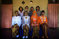 Villagers from a remote village in Lampung Province who received wedding production training initiated by the 'Twin Teachers' show the result of their work applied to other villagers who were asked to be models (front row). Aside from the training itself, the villagers also get to keep the wedding gowns and make-up donated by the twins. The trials and tribulations of the twin sisters' crusade has not deterred their passion for work. Instead, they have expanded to various parts of the country promoting training modules to gain practical skills as part of their adult education programme targeting women empowerment. Since the early 1990s, twin sisters Sri Rosyati (known as Rossy) and Sri Irianingsih (known as Rian) have used their family inheritance to set up and run 64 schools in different parts of Indonesia, providing primary education combined with practical skills to some of the country's most deprived children.   .