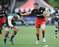 Chris Ashton of Saracens hands off Lachlan McCaffrey of Leicester Tigers during the Aviva Premiership semi final match between Saracens and Leicester Tigers at Allianz Park on Saturday 21st May 2016 (Photo: Rob Munro/Stewart Communications)