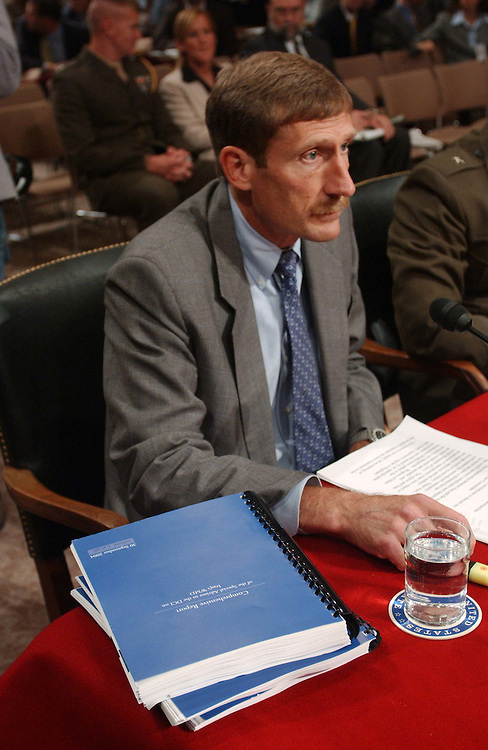 10/06/04.IRAQ AND WEAPONS OF MASS DESTRUCTION--Charles A. Duelfer, Special Advisor to the Director of Central Intelligence for Strategy Regarding Iraqi Weapons of Mass Destruction Programs, a copy of the report in front of him, before a Senate Armed Service hearing to receive a report on Iraqi weapons of mass destruction programs. Brigadier General Joseph J. McMenamin, USMC, commander of the Iraq Survey Group, also testified..CONGRESSIONAL QUARTERLY PHOTO BY SCOTT J. FERRELL