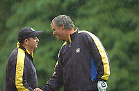 Ryder Cup K Club Straffin Co Kildare..European Ryder Cup Team player Darren Clarke shakes hands with team captain Ian Woosnam on the 17th green during the morning fourball session of the second day of the 2006 Ryder Cup at the K Club in Straffan, County Kildare, in the Republic of Ireland, 23 September, 2006..Photo: Barry Cronin/ Newsfile.