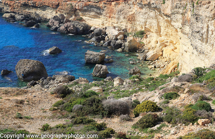 Coastal scenery crumbling cliffs and sea near Cirkewwa, Republic of Malta