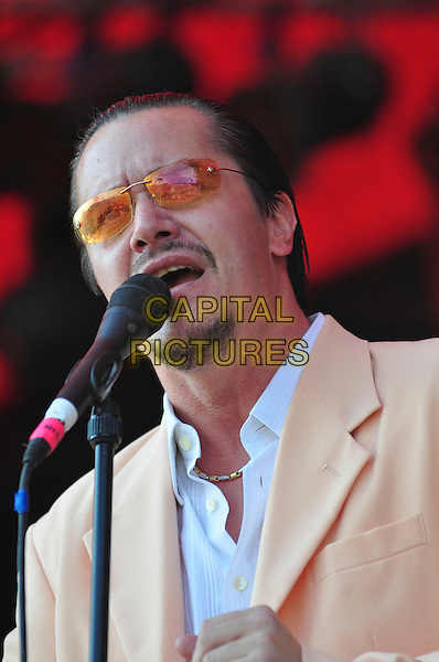 MIKE PATTON of FAITH NO MORE.performs on day two of the Roskilde Festival in Roskilde, Denmark, .July 3rd 2009..music gig concert performing on stage half length tinted glasses sunglasses peach jacket blazer beard facial hair goatee microphone singing .CAP/TTL .©TTL/Capital Pictures