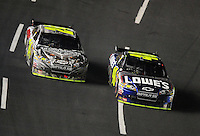 Oct. 17, 2009; Concord, NC, USA; NASCAR Sprint Cup Series driver Jimmie Johnson (48) races alongside teammate Jeff Gordon (24) during the NASCAR Banking 500 at Lowes Motor Speedway. Mandatory Credit: Mark J. Rebilas-