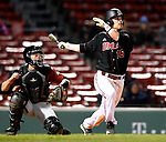 BOSTON, MA - APRIL 17: UMass' Collin Shapiro hits an RBI single against Harvard in the fifth inning during the 30th Annual Baseball Beanpot Championship Game at Fenway Park in Boston, Massachusetts on April 17, 2019. Photo by Christopher Evans