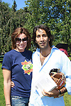 Countess LuAnn de Lessups poses with boyfriend Jacques Azoulay at the 63rd Annual Charity Softball Game 2011 - Artists versus Writers to benefit East Hampton Day Care Learning Center, East End Hospice and Phoenix Houses of Long Island - played at Herrick Park, East Hampton, New York. (Photo by Sue Coflin/Max Photos)