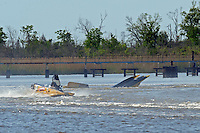 Frame 12: Terry Rinker (#10) and Chris Fairchild (#62) race up the back stright to turn 2 where Rinker's boat rolls over a wake, noses in and flips.   (Formula 1/F1/Champ class)