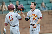 First baseman Mark Lowrie (15) of the Winthrop University Eagles, right, is congratulated by Chad Smith (13) after scoring a run in a game against the University of South Carolina Upstate Spartans on Wednesday, March 4, 2015, at Cleveland S. Harley Park in Spartanburg, South Carolina. Upstate won, 12-3. (Tom Priddy/Four Seam Images)