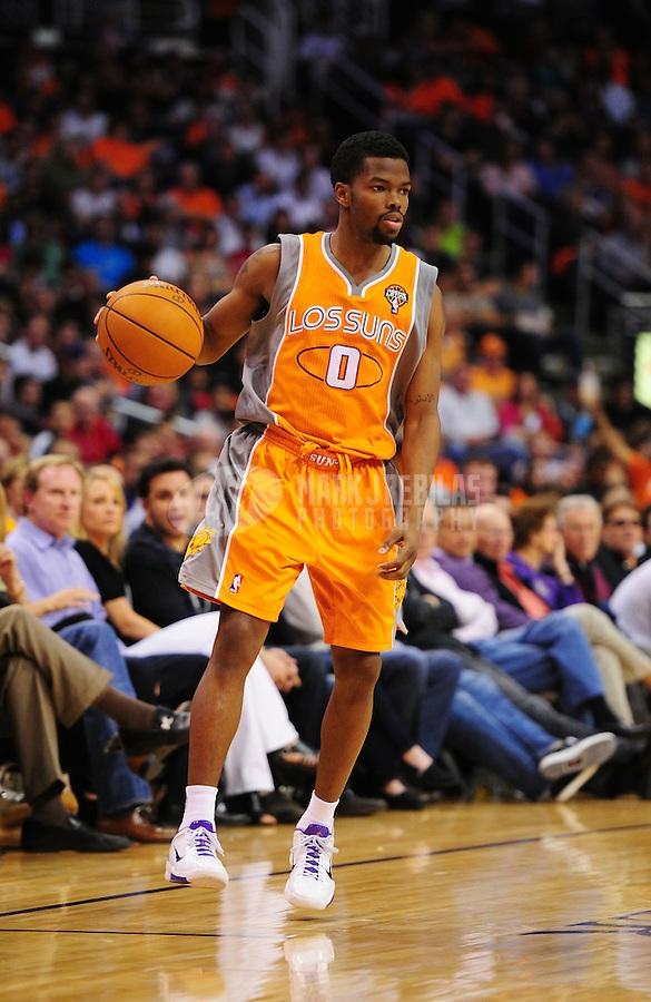 Mar. 25, 2011; Phoenix, AZ, USA; Phoenix Suns guard (0) Aaron Brooks against the New Orleans Hornets at the US Airways Center. The Hornets defeated the Suns 106-100. Mandatory Credit: Mark J. Rebilas-.