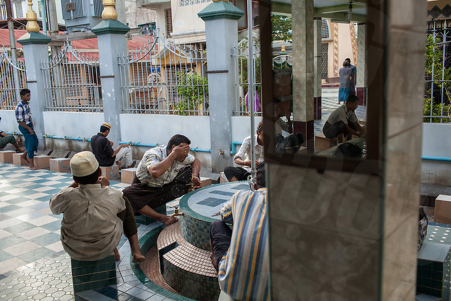 Muslim prepare for prayer at the Joon Mosque in central Mandalay. 07 June 2013 © Nicolas Axelrod / Ruom