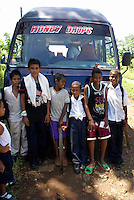 School children posing in front of a tourist bus on Big Corn Island, Nicaragua