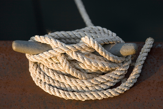Close-up of cleat and line (rope) holding boat at dock. Seneca Lake Park, Geneva, NY, USA.