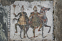 Detail of a mosaic depicting two men with a horse in the Villa of the Aviary, Carthage, Tunisia, pictured on January 27, 2008, in the afternoon. Carthage was founded in 814 BC by the Phoenicians who fought three Punic Wars against the Romans over this immensely important Mediterranean harbour. The Romans finally conquered the city in 146 BC. Subsequently it was conquered by the Vandals and the Byzantine Empire. Today it is a UNESCO World Heritage. The Roman Villa of the Aviary, with its octagonal garden set in a peristyle courtyard, is known for its fine mosaics depicting birds. Picture by Manuel Cohen.