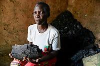 ZAMBIA, Sinazongwe District, Tonga village Kangwamina, people suffer from drought and hunger, the only source of income is charcoal / nach dem dritten Duerre Jahr leiden die Menschen zunehmend an Hunger und verfallen in Lethargie, Frau von  John Siambulo, verkaufen Holzkohle als Einnahmequelle