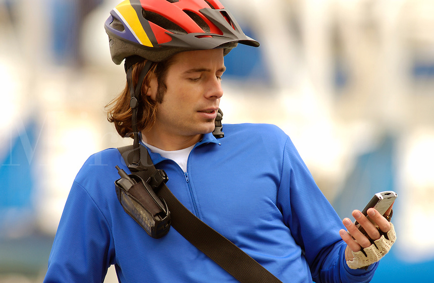 Biker stops to check messages on his PDA.