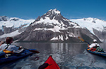 Alaska, Kenai Fjords National Park, Sea Kayakers in  Aialik Bay, glaciers and mountain peaks, Kenai Peninsula,.