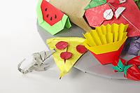 OrigamiUSA 2017 Holiday Tree at the American Museum of Natural History. Base 6 models:<br /> Cornucopia: Designer &ndash; Talo Kawasaki, Folder &ndash; Talo Kawasaki<br /> Mouth with Tongue (Grosera): Designer &ndash; Alexander Oliveros, Folder &ndash; Rosalind Joyce<br /> Jalapeno: Designer &ndash; Joseph Wu, Folder &ndash; Rosalind Joyce<br /> Coke bottle: Designer - Gilad Aharoni, Folder &ndash; Rosalind Joyce<br /> Rat: Designer &ndash; Eric Joisel, Folder &ndash; (from stored tree models collection)<br /> Pizza: Designer &ndash; Russell Cashdollar, Folder &ndash; Rosalind Joyce<br /> Watermelon slice: Designer &ndash; Shoko Aoyagi, Folder &ndash; Patty Grodner<br /> Watermelon half: Designer &ndash; Talo Kawasaki, Folder &ndash; Talo Kawasaki<br /> French Fries: Designer &ndash; Charles Esseltine, Folder &ndash; Donna Walcavage<br /> Strawberries: Designer &ndash; Rae Cooker, Folder &ndash; Rosalind Joyce<br /> Lemon half: Designer &ndash; Marc Vigo, Folder &ndash; Dan Cohen